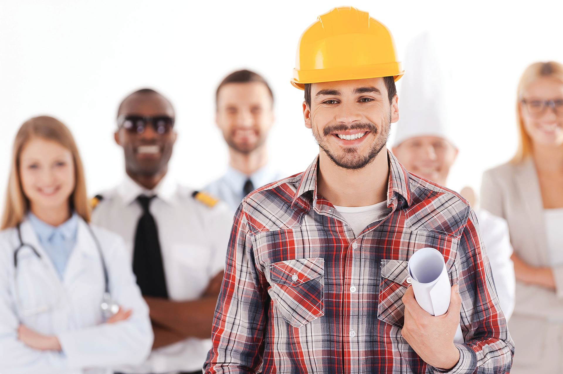 Man smiling wearing hard hat in front of group of union workers